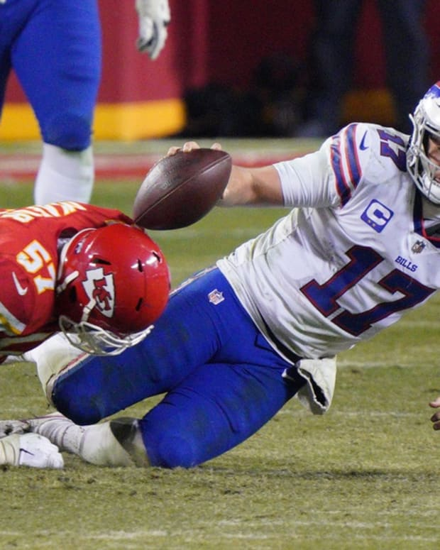 Bills quarterback Josh Allen (17) is tackled by Kansas City Chiefs defensive end Alex Okafor (57) during the fourth quarter in the AFC Championship Game at Arrowhead Stadium.