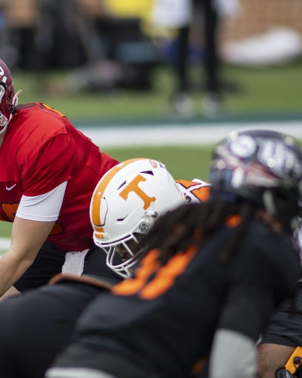 American quarterback Mac Jones of Alabama (10) runs a play in drills during National team practice during the 2021 Senior Bowl week.
