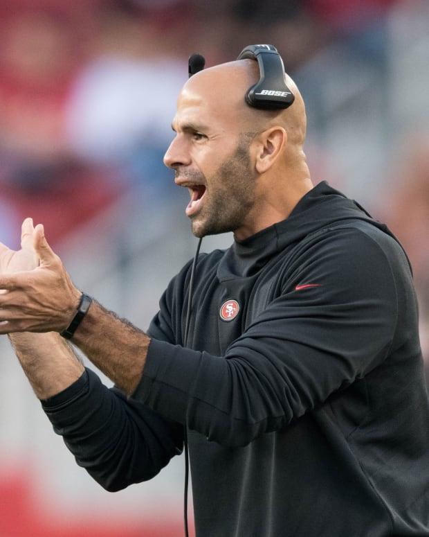 49ers defensive coordinator Robert Saleh cheering