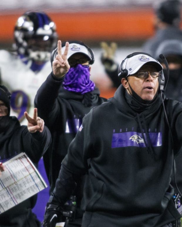 Dec 14, 2020; Cleveland, Ohio, USA; Baltimore Ravens assistant head coach David Culley, right, along with the coaching staff signal for the team to go for the two-point conversion following their touchdown against the Cleveland Browns during the fourth quarter at FirstEnergy Stadium. Mandatory Credit: Scott Galvin-USA TODAY Sports