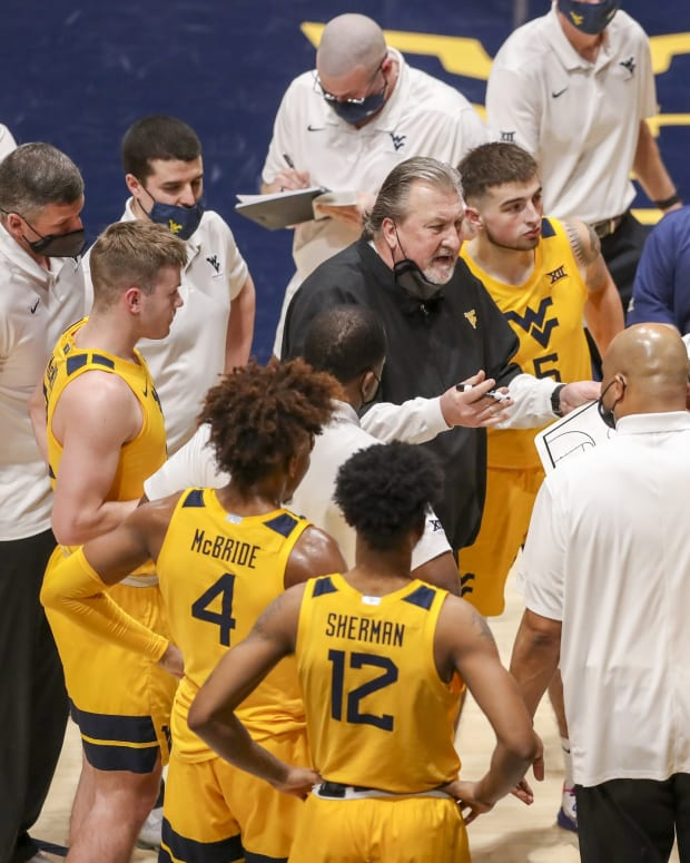 Jan 30, 2021; Morgantown, West Virginia, USA; West Virginia Mountaineers head coach Bob Huggins talks to his team during a timeout during the first half against the Florida Gators at WVU Coliseum.