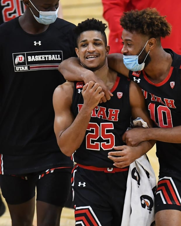 Jan 30, 2021; Boulder, Colorado, USA; Utah Utes guard Alfonso Plummer (25) and guard Jordan Kellier (10) celebrate defeating the Colorado Buffaloes at the CU Events Center.