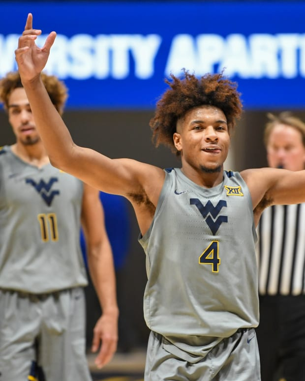 """West Virginia guard Miles """"Deuce"""" McBride (4) had a career-high 29 points in the win over No. 23 Kansas."""
