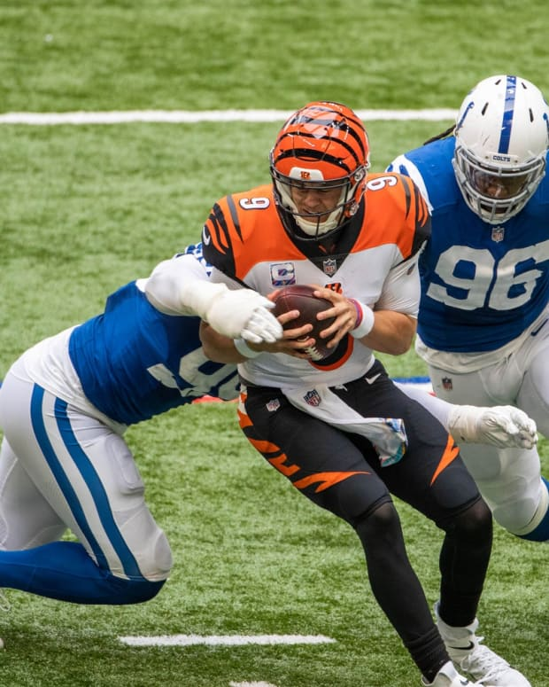 Indianapolis Colts defensive tackle DeForest Buckner (left) and defensive end Denico Autry (96) converge on Cincinnati Bengals quarterback Joe Burrow for a sack.