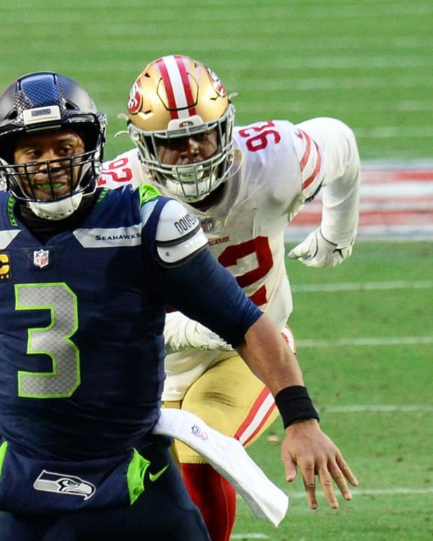 Jan 3, 2021; Glendale, Arizona, USA; Seattle Seahawks quarterback Russell Wilson (3) throws a touchdown pass against the San Francisco 49ers during the second half at State Farm Stadium. Mandatory Credit: Joe Camporeale-USA TODAY Sports