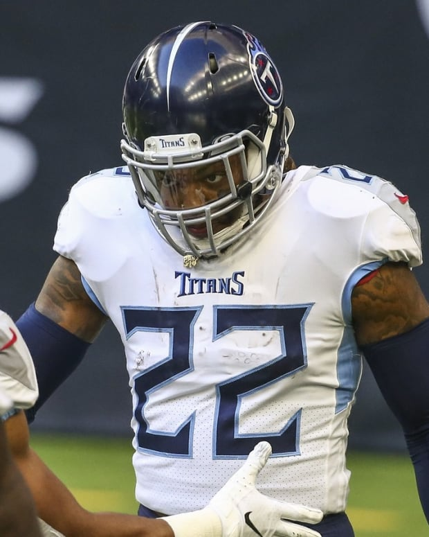 Tennessee Titans running back Derrick Henry (22) celebrates with teammates after scoring a touchdown during the second quarter against the Houston Texans at NRG Stadium.
