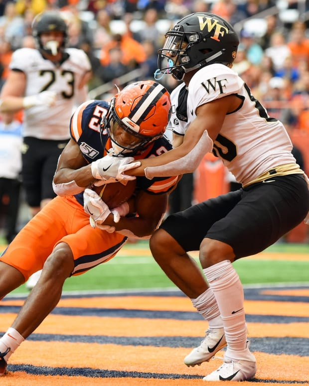 Nov 30, 2019; Syracuse, NY, USA; Syracuse Orange defensive back Ifeatu Melifonwu (23) intercepts a pass in the end zone in front of Wake Forest Demon Deacons wide receiver Waydale Jones (80) during the second quarter at the Carrier Dome.