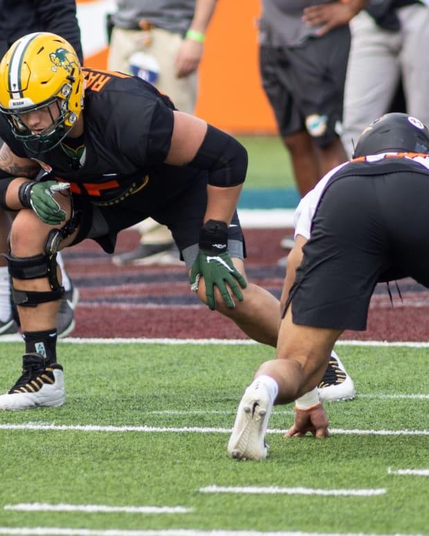 Jan 26, 2021; Mobile, Alabama, USA; National offensive lineman Dillon Radunz of North Dakota State (75) drills during National team practice during the 2021 Senior Bowl week.