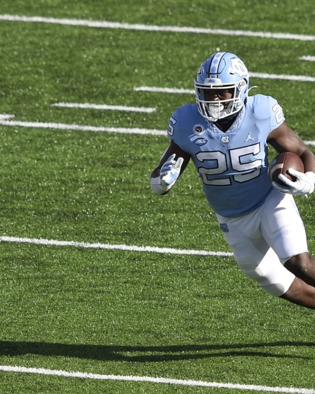 Dec 5, 2020; Chapel Hill, North Carolina, USA; North Carolina Tar Heels running back Javonte Williams (25) with the ball in the second quarter at Kenan Memorial Stadium.
