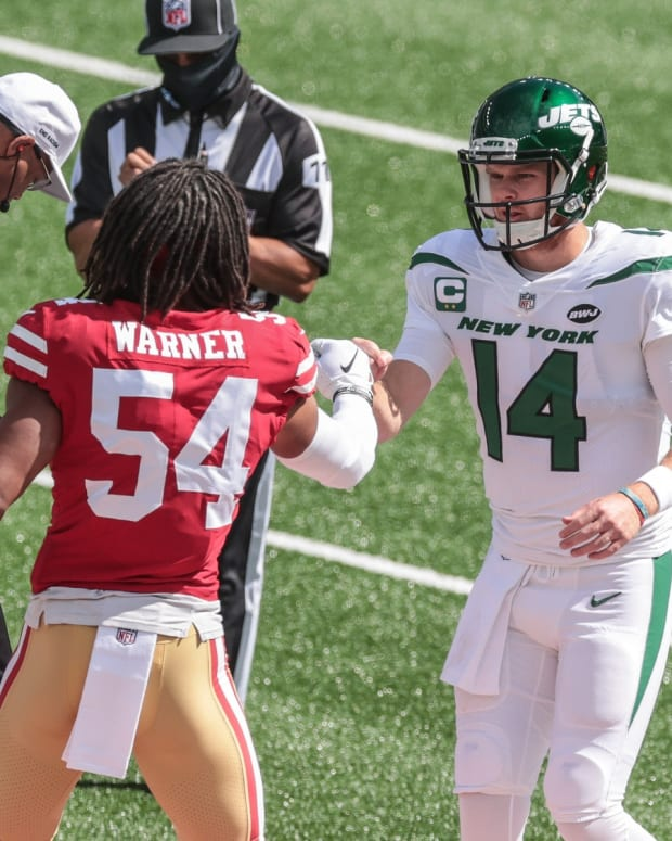 Jets QB Sam Darnold shakes hands with 49ers Fred Warner