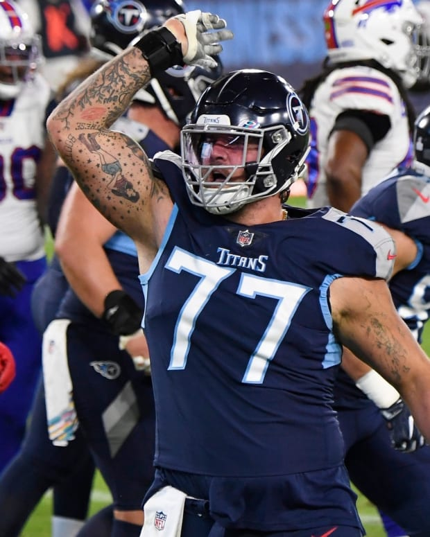 Tennessee Titans offensive tackle Taylor Lewan (77) calls for the fans to cheer after the touchdown by running back Derrick Henry (22) during the second quarter at Nissan Stadium Tuesday, Oct. 13, 2020 in Nashville, Tenn.
