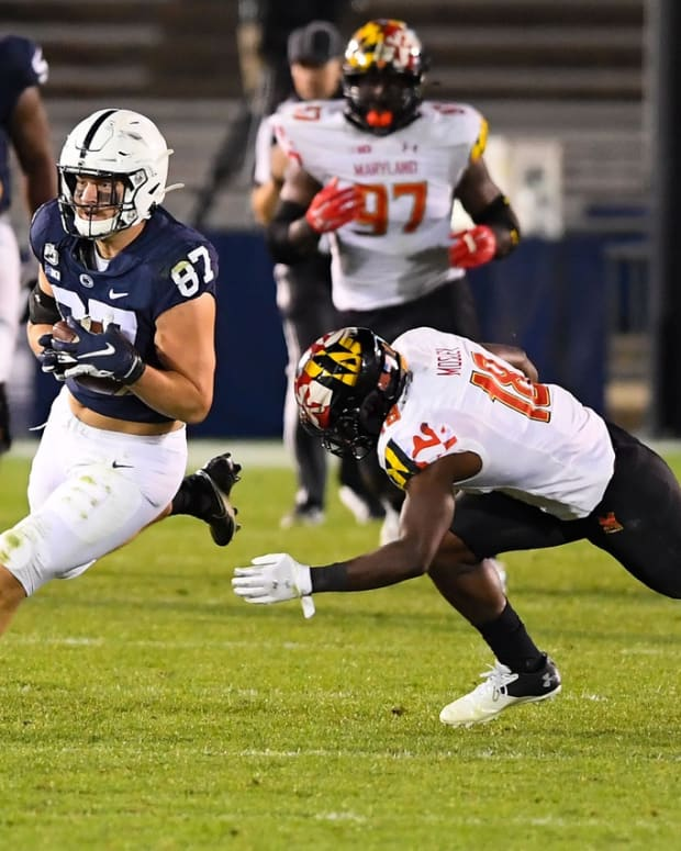 Nov 7, 2020; University Park, Pennsylvania, USA; Penn State Nittany Lions tight end Pat Freiermuth (87) runs with the ball after a catch as Maryland Terrapins defensive back Jordan Mosley (18) defends during the third quarter at Beaver Stadium.