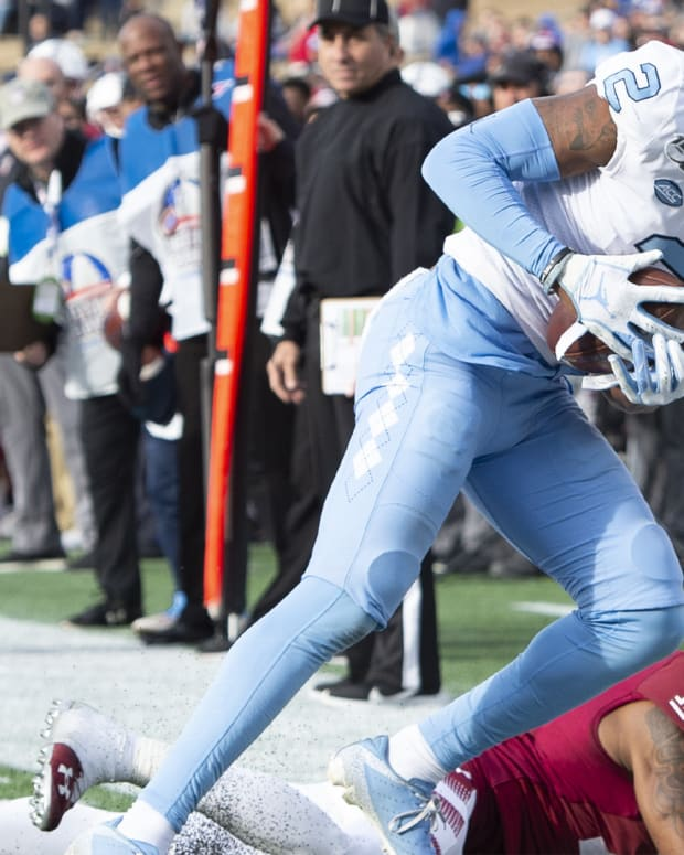 Dec 27, 2019; Annapolis, Maryland, USA; Temple Owls cornerback Christian Braswell (14) pushes North Carolina Tar Heels wide receiver Dyami Brown (2) out of bounds at the one yard line during the third quarter at Navy-Marine Corps Memorial Stadium. Mandatory Credit: Tommy Gilligan-USA TODAY Sports