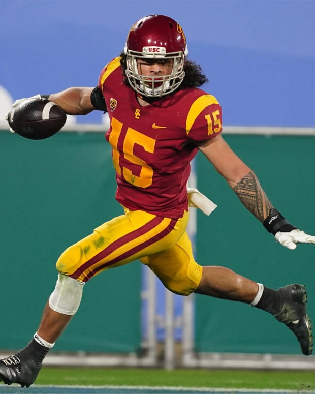 Dec 12, 2020; Pasadena, California, USA; Southern California Trojans safety Talanoa Hufanga (15) celebrates after an interception in the fourth quarter against the UCLA Bruins at Rose Bowl. USC defeated UCLA 43-38. Mandatory Credit: Kirby Lee-USA TODAY Sports