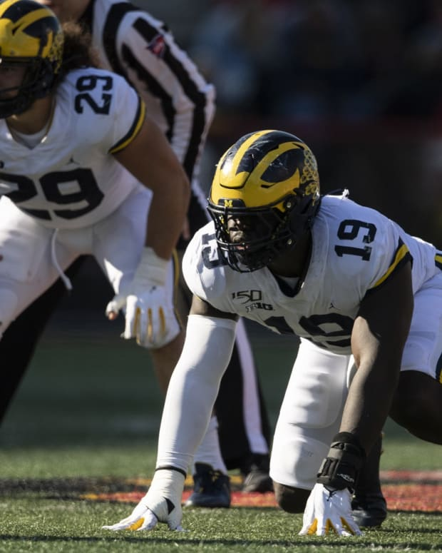 Nov 2, 2019; College Park, MD, USA; Michigan Wolverines defensive lineman Kwity Paye (19) and linebacker Jordan Glasgow (29) prior to the snap during the \2g\ against the Maryland Terrapins at Capital One Field at Maryland Stadium. Mandatory Credit: Tommy Gilligan-USA TODAY Sports