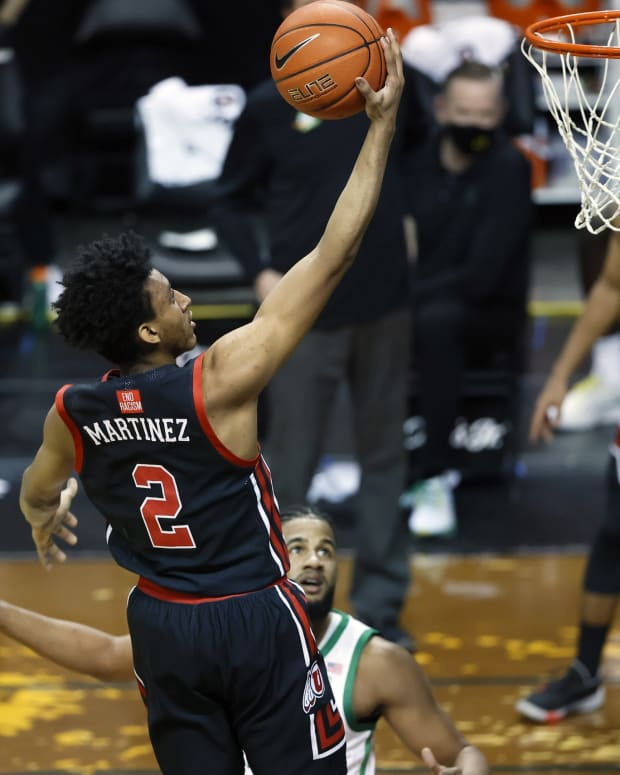 Feb 20, 2021; Eugene, Oregon, USA; Utah Utes guard Ian Martinez (2) shoots the ball during the first half against the Oregon Ducks at Matthew Knight Arena.
