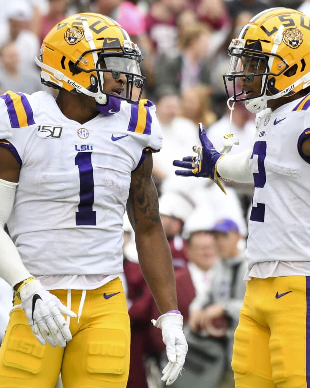 Oct 19, 2019; Starkville, MS, USA; LSU Tigers wide receiver Ja'Marr Chase (1) and wide receiver Justin Jefferson (2) react after a touchdown against the Mississippi State Bulldogs during the second quarter at Davis Wade Stadium. Mandatory Credit: Matt Bush-USA TODAY Sports