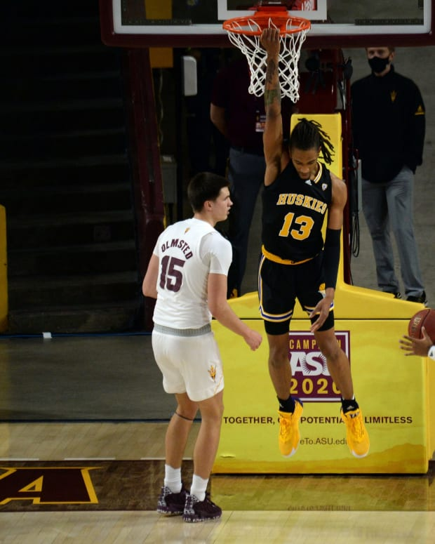 Hameir Wright dunks in one of the few Husky bright spots at ASU>