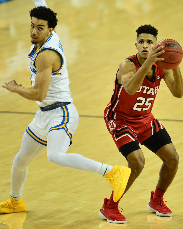 Dec 31, 2020; Los Angeles, California, CA; Utah Utes guard Alfonso Plummer (25) shoots against UCLA Bruins guard Jules Bernard (1) during the second half at Pauley Pavilion.