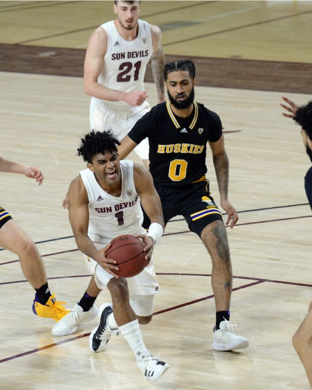 Four Huskies converge on ASU's Remy Martin.