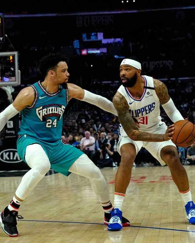 Feb 24, 2020; Los Angeles, California, USA; LA Clippers forward Marcus Morris Sr. (31) is guarded by Memphis Grizzlies guard Dillon Brooks (24) in the second half at Staples Center. Mandatory Credit: Kirby Lee-USA TODAY Sports