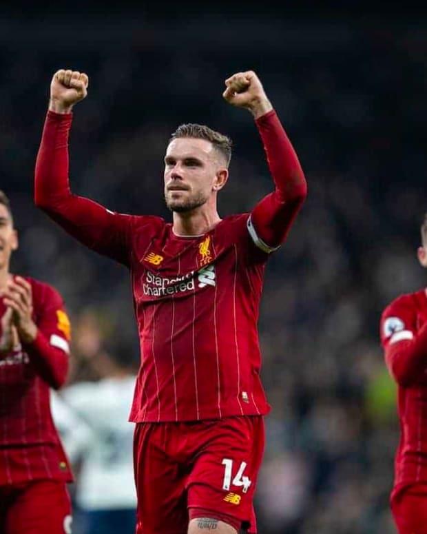 Jordan Henderson leads the celebrations after Liverpool defeat Tottenham.