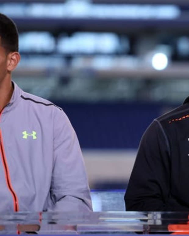 Florida State quarterback Jameis Winston (right) and Oregon Ducks quarterback Marcus Mariota do an interview on the NFL Network after finishing their workout during the 2015 NFL Combine at Lucas Oil Stadium.