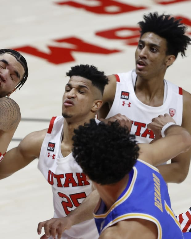 Feb 25, 2021; Salt Lake City, Utah, UCA; Utah Utes forward Timmy Allen (1) intercepts a pass by UCLA Bruins guard Jules Bernard (1) in the first half at Jon M. Huntsman Center. Mandatory Credit: Jeffrey Swinger-USA TODAY Sports