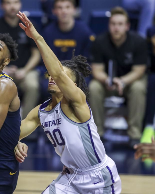 Feb 1, 2020; Morgantown, West Virginia, USA; West Virginia Mountaineers forward Derek Culver (1) drives baseline past Kansas State Wildcats guard Mike McGuirl (00) during the second half at WVU Coliseum.
