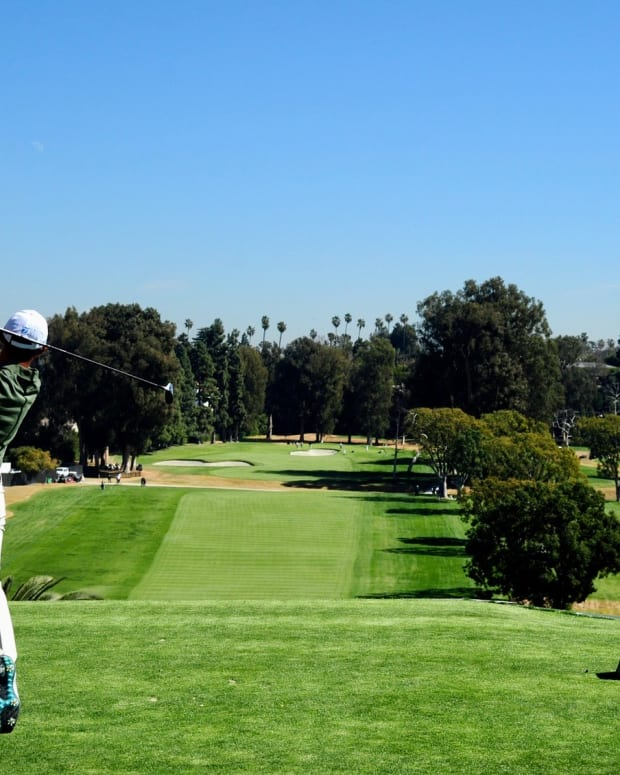 Collin Morikawa hits his tee shot on the 4th hole Friday