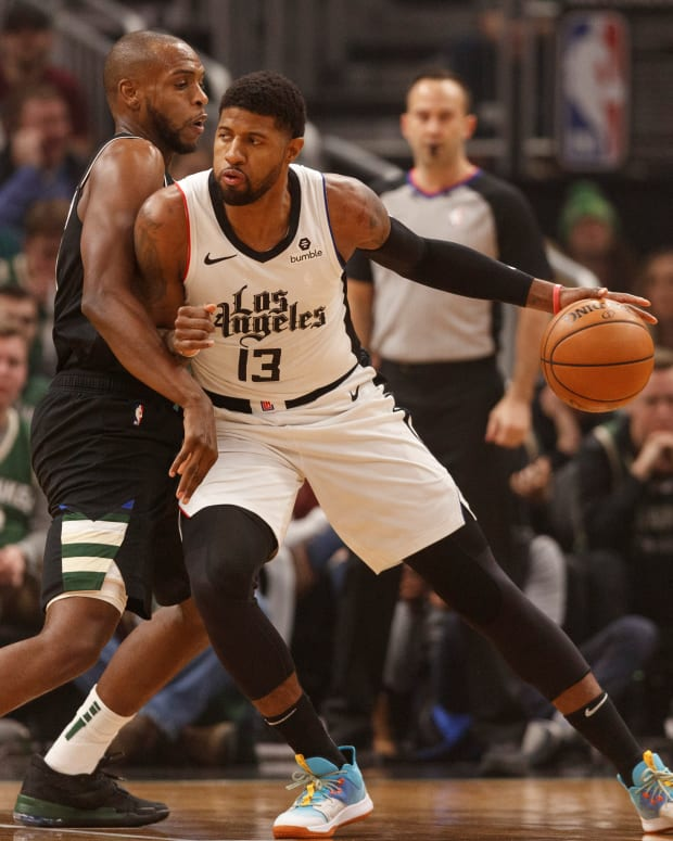 Dec 6, 2019; Milwaukee, WI, USA; Los Angeles Clippers forward Paul George (13) works for a shot against Milwaukee Bucks forward Khris Middleton (22) during the first quarter at Fiserv Forum. Mandatory Credit: Jeff Hanisch-USA TODAY Sports