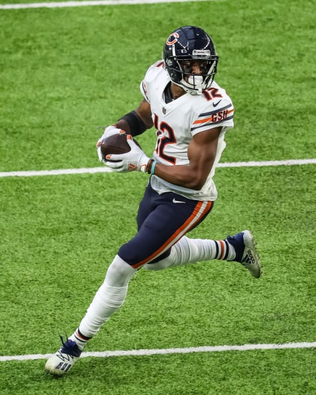 Dec 20, 2020; Minneapolis, Minnesota, USA; Chicago Bears wide receiver Allen Robinson (12) runs with the ball during the fourth quarter against the Minnesota Vikings at U.S. Bank Stadium. Mandatory Credit: Brace Hemmelgarn-USA TODAY Sports