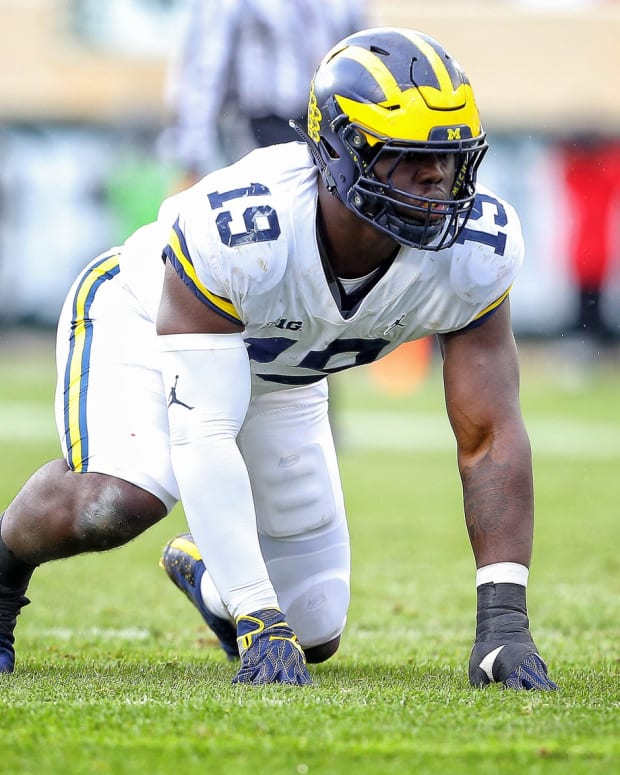 Michigan defensive lineman Kwity Paye