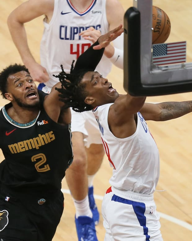 Feb 26, 2021; Memphis, Tennessee, USA; Los Angeles Clippers guard Terance Mann (14) shoots in the second half as Memphis Grizzlies center Xavier Tillman (2) defends during the second half at FedExForum. Clippers won 119-99. Mandatory Credit: Nelson Chenault-USA TODAY Sports