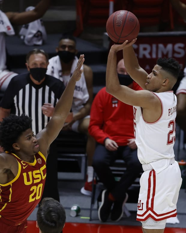 Feb 27, 2021; Salt Lake City, Utah, USA; Utah Utes guard Alfonso Plummer (25) shoot for a three against USC Trojans guard Ethan Anderson (20) in the second half at Jon M. Huntsman Center.