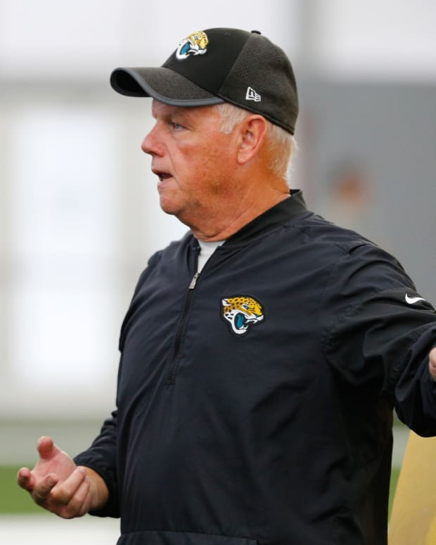 May 22, 2018; Jacksonville, FL, USA; Jacksonville Jaguars offensive line coach Pat Flaherty talks to his players during organized team activities at TIAA Bank Field.