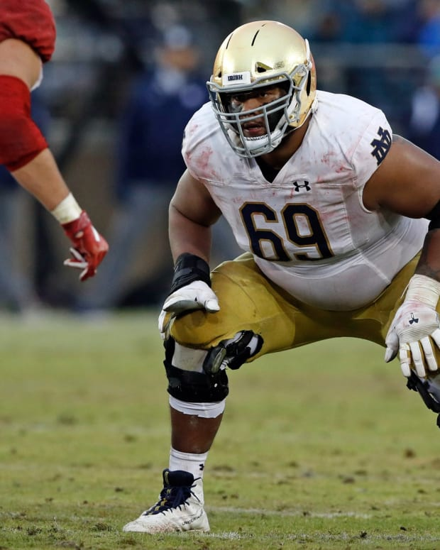 Nov 30, 2019; Stanford, CA, USA; Notre Dame Fighting Irish offensive lineman Aaron Banks (69) waits for the snap during the fourth quarter against the Stanford Cardinal at Stanford Stadium. Mandatory Credit: Darren Yamashita-USA TODAY Sports