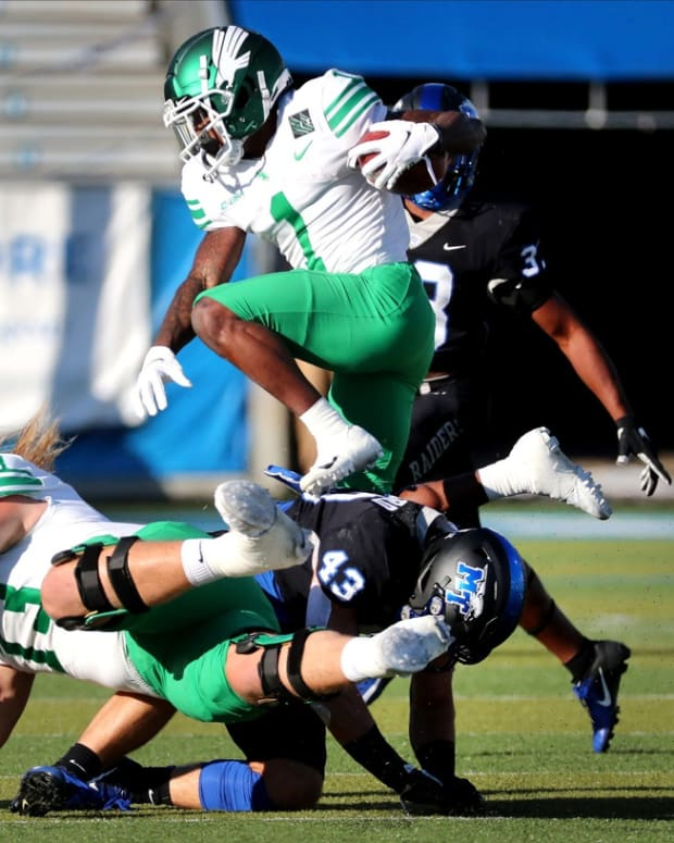 North Texas wide receiver Jaelon Darden (1) runs over MTSU linebacker Brett Shepherd's (43) back as he runs the ball on Saturday, Oct. 17, 2020, during the Blackout game at MTSU. 8 Mtsu V North Texas