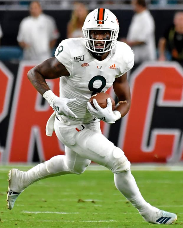 Oct 11, 2019; Miami Gardens, FL, USA; Miami Hurricanes tight end Brevin Jordan (9) carries the ball against the Virginia Cavaliers during the second half at Hard Rock Stadium. Mandatory Credit: Steve Mitchell-USA TODAY Sports