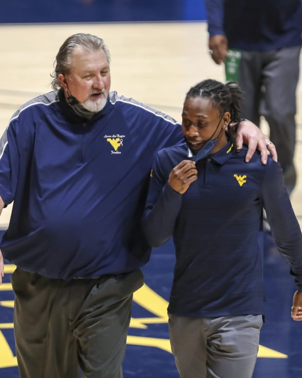 Feb 27, 2021; Morgantown, West Virginia, USA; West Virginia Mountaineers head coach Bob Huggins and graduate assistant Juwan Staten walk off the floor after the West Virginia Mountaineers defeated the Kansas State Wildcats at WVU Coliseum