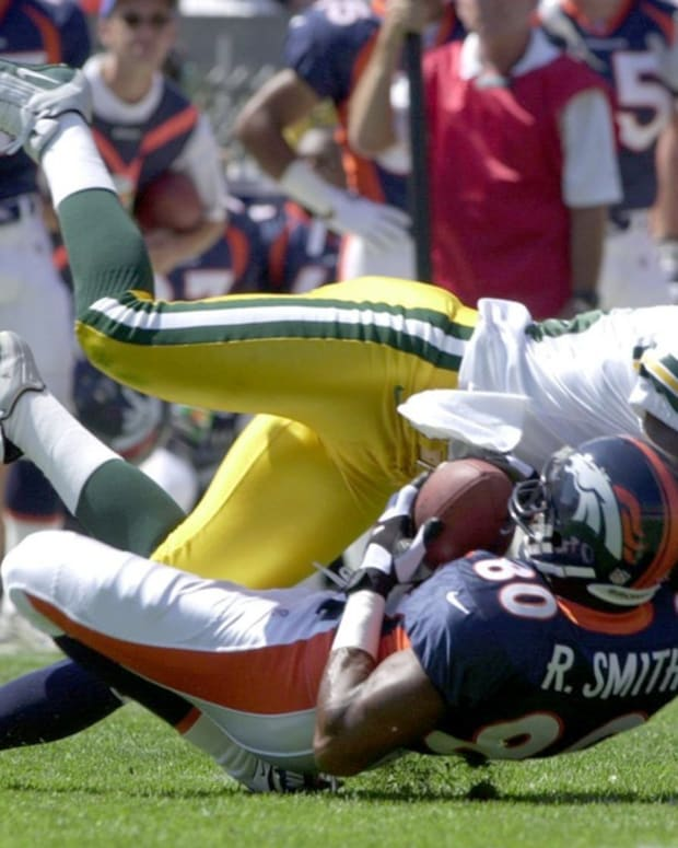 Green Bay Packers Leroy Butler knocks down Bronco receiver Rod Smith after a reception during first half play against the Denver Broncos on Sunday, Aug. 13, 2000 at Mile High Stadium in Denver. Rod Smith Of Denver And Leroy Butler Of The Packers