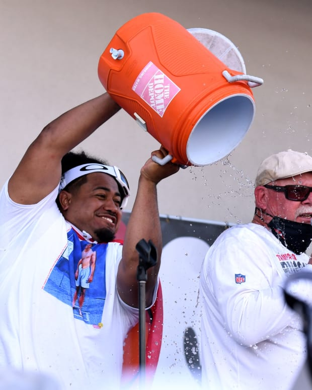 Vita Vea drenches Bucs coach Bruce Arians in the Super Bowl celebration.