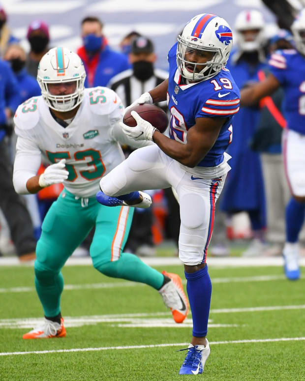 Jan 3, 2021; Orchard Park, New York, USA; Buffalo Bills wide receiver Isaiah McKenzie (19) catches a pass in front of Miami Dolphins middle linebacker Kyle Van Noy (53) during the second quarter at Bills Stadium.