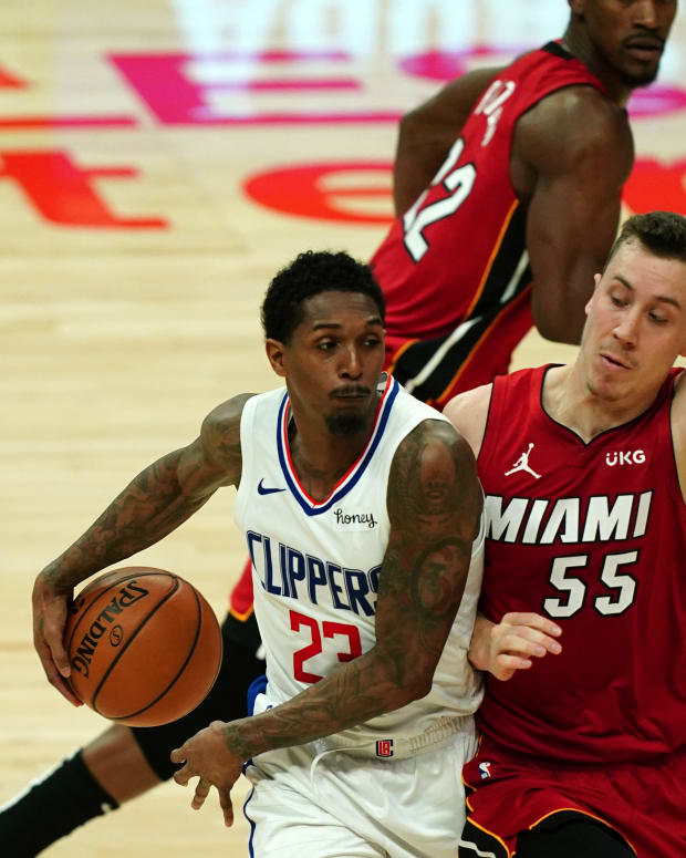Feb 15, 2021; Los Angeles, California, USA; LA Clippers guard Lou Williams (23) passes the ball around the back of Miami Heat guard Duncan Robinson (55) in the second half at Staples Center. Mandatory Credit: Kirby Lee-USA TODAY Sports