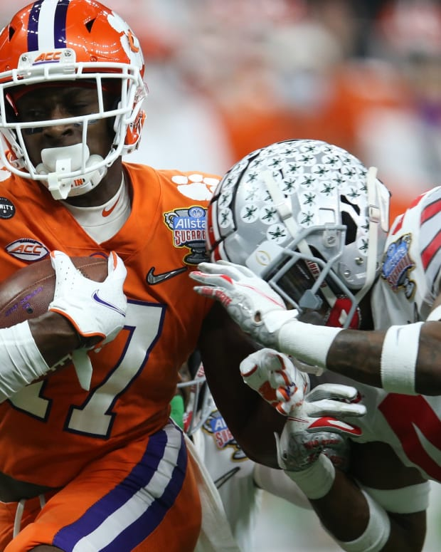 Jan 1, 2021; New Orleans, LA, USA; Clemson Tigers wide receiver Cornell Powell (17) is hit by Ohio State Buckeyes safety Josh Proctor (41) while running the ball during the second half at Mercedes-Benz Superdome.