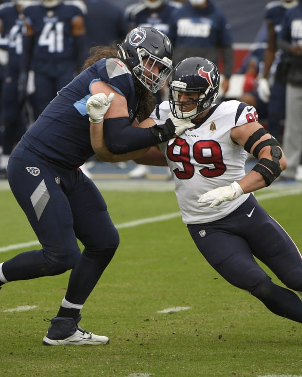 Houston Texans defensive end J.J. Watt (99) rushes as Tennessee Titans offensive tackle Taylor Lewan (77) defends during pre-game at Nissan Stadium.