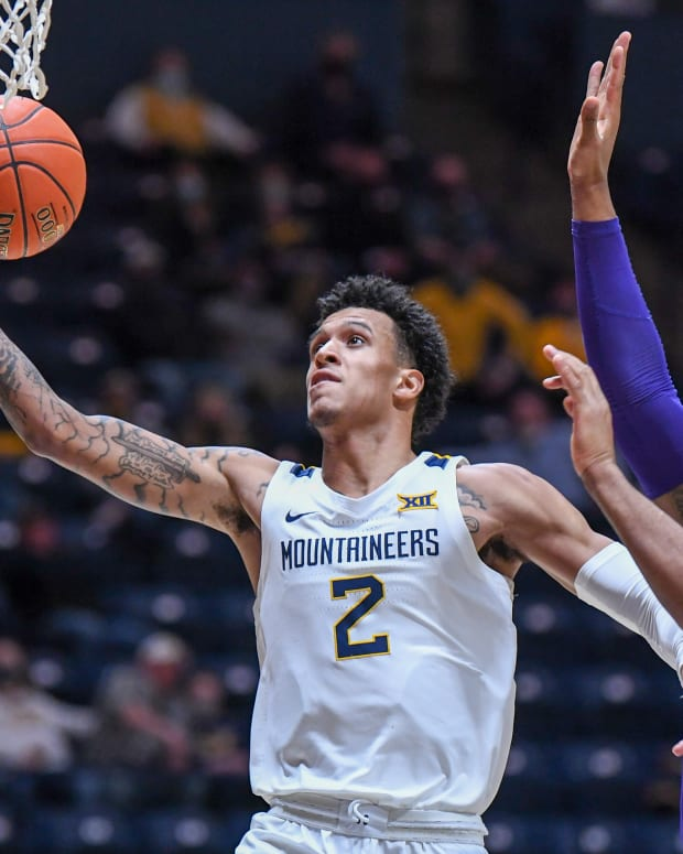 West Virginia forward Jalen Bridges drives the lane for one of his five field goals on the evening on his way to a career-high 22 points and grabbed a career-high 12 rebounds.