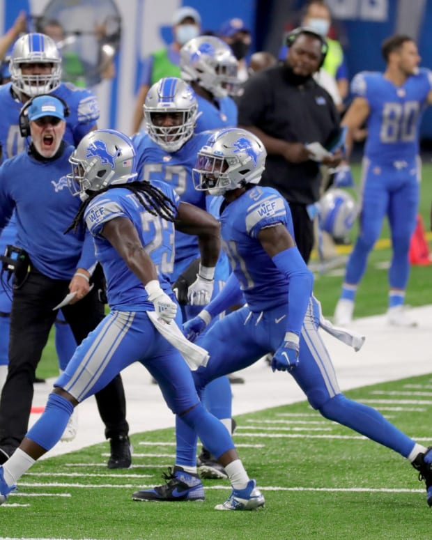 Desmond Trufant celebrates his lone interception for the Lions.