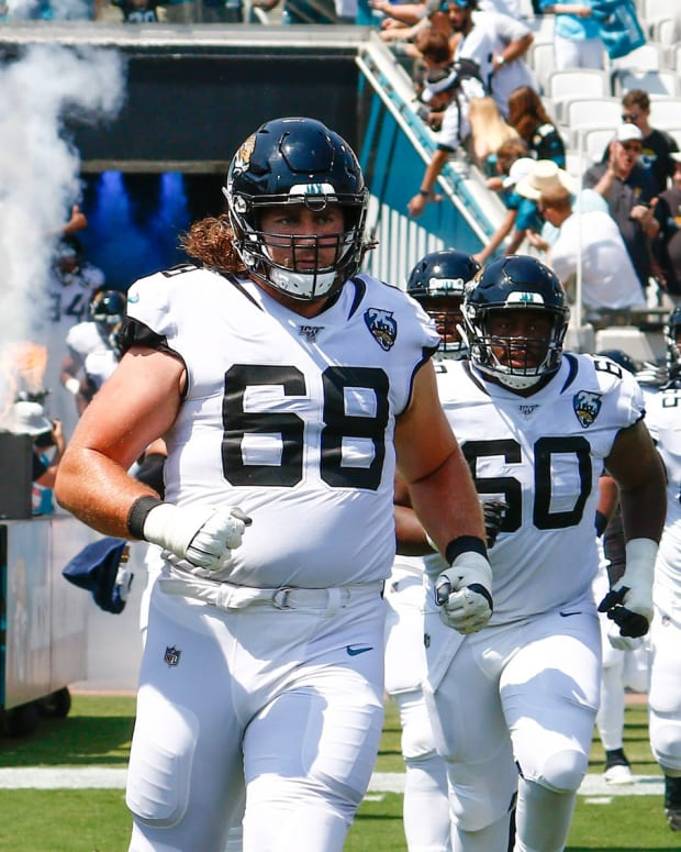 Sep 8, 2019; Jacksonville, FL, USA; Jacksonville Jaguars offensive guard Andrew Norwell (68) and offensive guard A.J. Cann (60) and center Brandon Linder (65) and offensive tackle Jawaan Taylor (75) run from the tunnel before the game against the Kansas City Chiefs at TIAA Bank Field. Mandatory Credit: Reinhold Matay-USA TODAY Sports