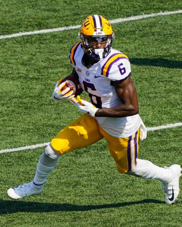 Oct 10, 2020; Columbia, Missouri, USA; LSU Tigers wide receiver Terrace Marshall Jr. (6) runs against the Missouri Tigers during the second half at Faurot Field at Memorial Stadium.